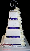 Celebrate your Wedding with an Beautiful White Wedding Cake with Quilting