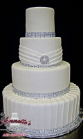 Celebrate your Wedding with an Beautiful Cream Wedding Cake with Simple Folds and Bling