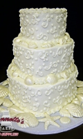 Celebrate your Beach Side Wedding with an Themed Wedding Cake with White Icing and Candy Shells384