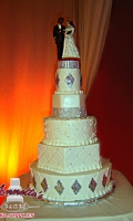 Celebrate your Wedding with an Beautiful White Wedding Cake with Simple Patterned Bling